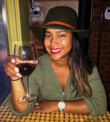 My friend Dunia with a glass of red wine.